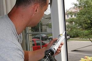 worker sealing a door